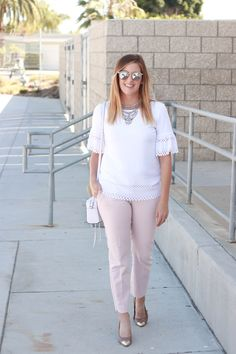The perfect pair of blush pants with an eyelet detailed top and a white Rebecca Minkoff crossbody bag.