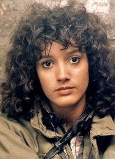 Jennifer Beals rocks curly bangs.