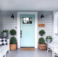 Love this front door. Beautiful teal, light blue green with gray siding...