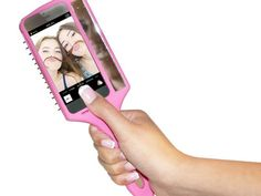 Feed your inner narcissist with the Selfie Brush, a combination of a hair brush, iPhone case, and mirror.