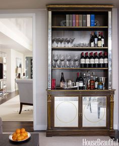"""<p>An antique bookcase doubles as a bar in this <a href=""""http://www.housebeautiful.com/photos/home-bar-design-ideas-1012"""" target=""""_blank"""">Manhattan apartment</a> decorated by Phoebe and Jim Howard. Glassware by William Yeoward Crystal.</p>"""