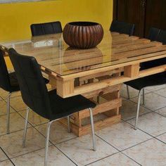a table made from several pallets... would be very cute if the pallets were painted. Could also just use the pallets for the structure, and place a sheet of wood across the top, along with the sheet of glass