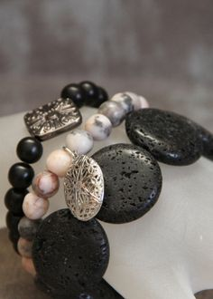 3-piece Stacker Diffuser Locket Bracelet Set made with Lave Rock, Wood & Rhodonite Embellished with a Gunmetal bead
