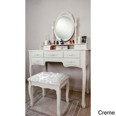 Start your morning in the grandest way with the Grand De Lux vanity, featuring a vintage-inspired desk with seven drawers, a swiveling mirror, and elegant stool. The stool is upholstered in a damask c