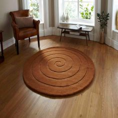 This Spiral Gold Brown Rug By Think Rugs is stylish and made from wool that has been hand-carved and hand-tufted. In gorgeous hues of solid brown, this rug features a contemporary modern spiral design. Circular Rugs, Circle Rug, Gold Rug, Black Rug, Hand Tufted Rugs, Natural Rug, Red Rugs, Modern Rugs, Modern Living
