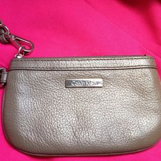 - FINAL PRICE - Calvin Klein Wristlet Calvin Klein wristlet. In great condition in and out. It has some scratches on the metal logo but not noticeable unless you look really close. Price has been adjusted due to that. I only used it once to a wedding. No trades. Calvin Klein Bags Clutches & Wristlets