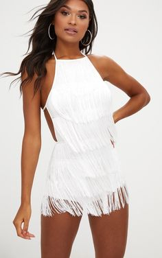 White Tassel PlaysuitUp your all-in-one game with this white tassel playsuit. Featuring a haltern...