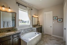 Gehan Homes Master Bathroom - Gray tile, granite countertop, dark wood cabinets, drop in tub, gray walls. Dallas, Texas   Kreymer Estates - Sycamore #Gehanhomes