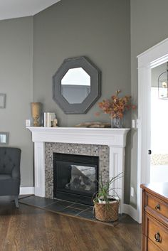 Are you looking for some amazing ideas for your new corner fireplace? Explore the top best corner fireplace designs featuring luxury angled interior ideas and inspiration. Fireplace Hearth Tiles, Corner Gas Fireplace, Fireplace Redo, Fireplace Remodel, Living Room With Fireplace, Fireplace Surrounds, Fireplace Design, Home Living Room, Living Room Decor