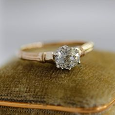 Regal engagement ring has a six prong crown and gracefully fluted shoulders. Center stone is a .72 vintage old mine cut diamond .72 carats L color and VS1 clarity with GIA report. This is an exact replica of an original Edwardian antique engagement ring. 14k yellow and white gold. Size 6. Deco Engagement Ring, Antique Engagement Rings, Halo Diamond Engagement Ring, Three Stone Diamond Ring, Clarity, Eclectic Wedding, White Gold, Crown, Yellow