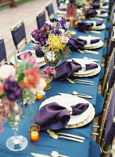 Long table with jewel toned linens. Michelle Leo Events. Photography: Chudleigh Weddings - chudleighweddings.com  Read More: http://www.stylemepretty.com/destination-weddings/2014/01/21/rustic-park-city-wedding-at-canyons-resort/