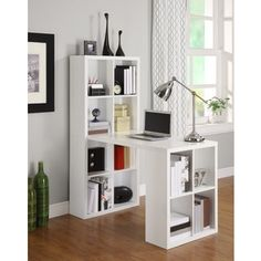 Add a fabulous and functional touch to your home decor with this white hobby desk. This Desk keeps all your essentials within arm's reach, but also keeps your work space clutter free. The 12 storage c