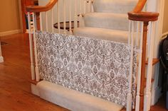 The Paper Gate -- Good for childproofing on tricky staircases- cardboard covered with fabric- velcro to sides