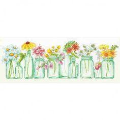 Borduurpakket van een rij potjes gevuld met fleurige bloemen.