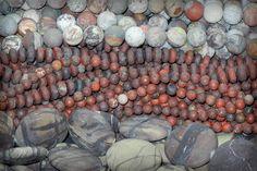 Matte gemstone beads cut from laguna lace, poppy jasper, and purple creek jasper: