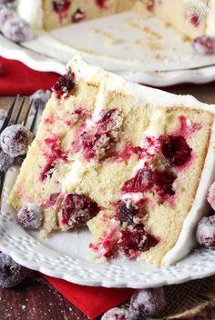 Sparkling Cranberry White Chocolate Cake - super moist vanilla cake full of fresh cranberries, iced with white chocolate icing and topped with sparking cranberries!