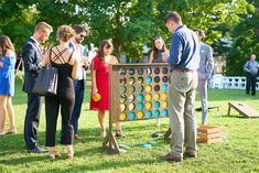 We love this handcrafted wooden reception game for guests to enjoy!