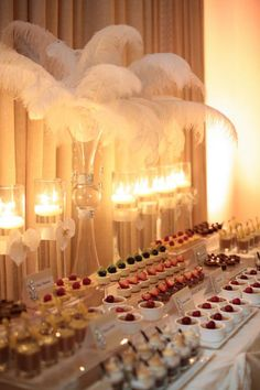 Romantic reception decor. The combination of candles and feathers is perfect if you want to achieve a sophisticated and elegant mood for your reception.