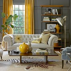 Hide rug over sisal in the living room