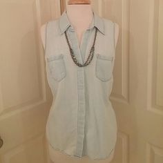 "Light denim top Like new - only worn a handful of times.  Light color denim button up top.  Panel hides buttons (see 3rd photo).  flat bust measurement 21"".  Length 24.5"".  Necklace in cover photo is also for sale in my closet. Sonoma Tops"