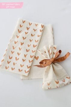 Painted fabric gift bags.