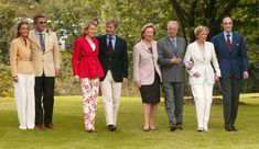 Princess Claire, Prince Laurent, Princess Mathilde, Prince Philippe, Queen Paola, King Albert, Princess Astrid and Prince Lorenz pose for a photo in the park at the Royal Palace on in May  2013