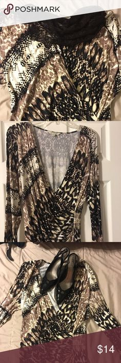 Fun Casual Top - You Can Dress Up Or Down! Tantrums V cut Top.  95% rayon 5% spandex - makes soft and very comfortable!! Dress it up with heels and a scarf or down with jeans and a tank top underneath.  Worn only once - Like New! Tantrums Tops Blouses