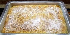 Recipe for Gooey Butter Cake - a truly decadent and easy to make dessert.  Photograph included.