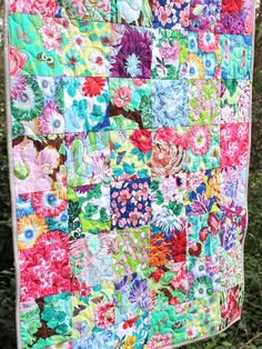 This modern baby girl quilt is completed and ready to ship to you! It features a beautiful, vibrant mix of 24 different floral fabrics in a classic