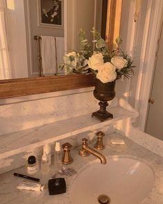 bathroom sink basin photography aesthetics golden hour // flower decor // gold hardware accessory