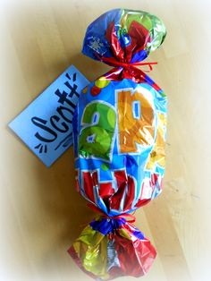 Just for fun:  Re-use an old mylar or foil balloon as gift-wrap.