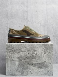 Valentino's green stonewashed-canvas derby shoes are finished with a heavy-duty rubber sole to enhance the utilitarian feel of the signature camouflage print.