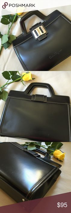 """Black handbag/cross-body with tan stitching. Elegant black handbag/cross-body with tan stitching.  Measures 13""""L X 8""""W X 9.5""""H and 13""""H including handle.  Includes cross-body strap (see photo).  Material looks like real leather do not see a tag to confirm, does not look or feel like vegan, (man made leather) but unable to confirm.  Interior has center zip pocket, interior side zip pocket, and two sections at each side of center zip pocket.  Magnetic buckle closure.  Beautiful condition…"""