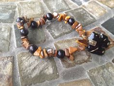 Tigers eye elephant root chakra bracelet on Etsy, $11.50
