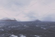 April Snow Shower over the Sea by PhotoMarket on @creativemarket
