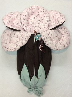 Baby bunting. Brown outside with flannel diaper pins on pink