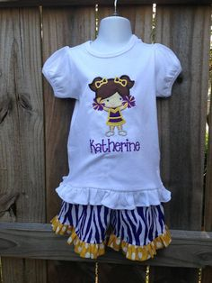 Smock Your Tot - Purple Tiger Stripe Shorts with Appliqued Purple and Gold Cheerleader Shirt or Onesie, $38.95 (http://www.smockyourtot.com/purple-tiger-stripe-shorts-with-appliqued-purple-and-gold-cheerleader-shirt-or-onesie/)
