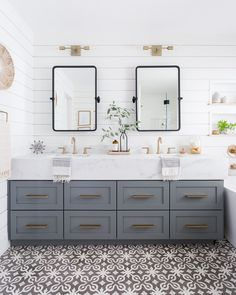 Gorgeous Hampton style bathroom. Love the shiplap and the tilting mirrors
