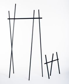 Thin black aluminium elements connect without screws to create this clothes rack by German designer Martha Schwindling that looks like a simple sketch. Clothes Stand, Clothes Racks, Chair Design, Furniture Design, Aluminum Element, Shelving Systems, Exhibition Poster, Wardrobe Rack, Architecture