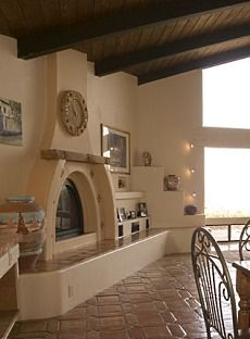 Kiva Fireplace: This would look perfect in my living room.  I like the elevated fireplace and the built-in niches.