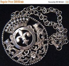 Vintage Dragon Fleur de lis Necklace, Statement Jewelry, Mid Century Collectibles, Mad Men Mod, Retro Rockabilly Accessories, 1960s 1970s Style: Mid Century Color: silver tone metal Size: 18 inches long by 2 1/2 inch wide by 3 inch Condition: Very good vintage condition Approximate Date: 1960s 1970s Hallmarks/signature: None but nicely made, Makes a great statement! Such a fun piece! Great addition to any collection.....  For more necklaces.....  https://www.etsy.com/...