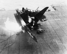 A Curtiss SB2C-4 Helldiver after a crash landing on the deck of the USS Shangri-La. Sadly, the rear gunner's body can be seen to the right of the aircraft.