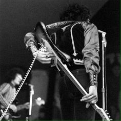 Jimi Playing With His Guitar Behind Head