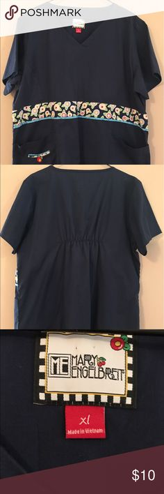 Mary Engelbreit XL Scrubs Top Navy Blue Mary Engelbreit Scrubs Top, size XL, navy blue with front side pockets. Very good preowned condition. Mary Engelbreit Tops