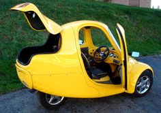 Myers Motors NMG (no more gas) one seat electric car – a tricycle.