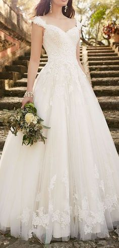 The lace wedding dress with cap sleeves is an instant classic from Essense of Australia