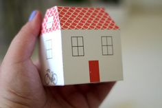 In this #DIY project Mel Stringer and Maddy Young, you'll learn how to make your own tiny town of cozy paper #houses . Use them to decorate a wedding celebration as customized place cards, clustered together as a centerpiece, or as party favors filled with a secret surprise. We've also included  free PDF templates in four colorways which you can print out, fold up, and wow your guests.