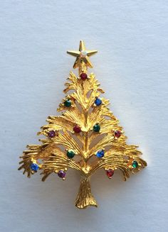 Vintage signed Eisenberg Ice gold tone colored rhinestone Christmas tree brooch 2 Inches long. Minty excellent condition.
