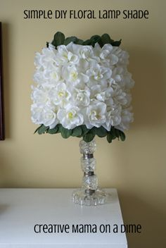 Simple & inexpensive DIY floral lamp shade using silk flowers from dollar store.