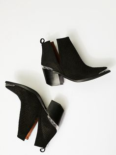 Hunt The Plains Boot   Suede ankle boots with a western-inspired design, etched metal heel and toe caps, and sculptural V-cut sides. Easily bend and mold upper to hold a coveted slouchy shape.